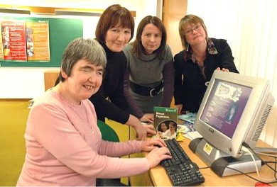 Sue showing her mum, sister and social worker the website